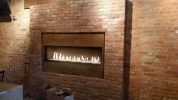 Refaced modern indoor fireplace